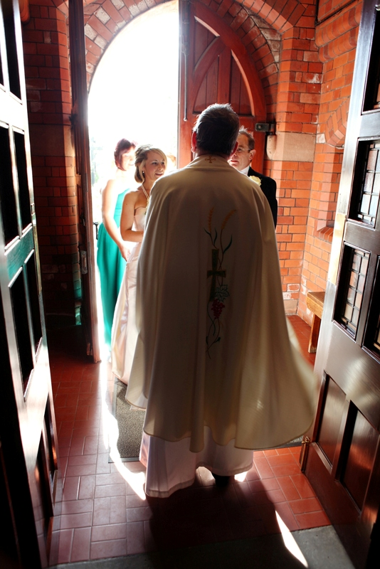 the bride is met by the priest, St Agnes RC Church wedding