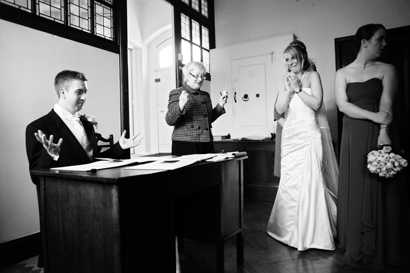 the bride and groom, contract signing, St Agnes RC Church wedding