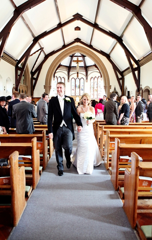 the bride and groom walking down the aisle, St Agnes RC Church wedding