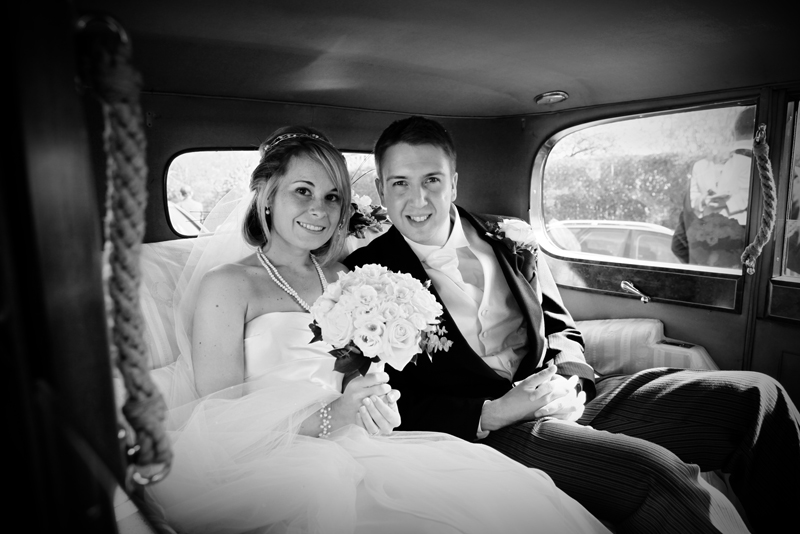 the bride and groom in car, St Agnes RC Church wedding