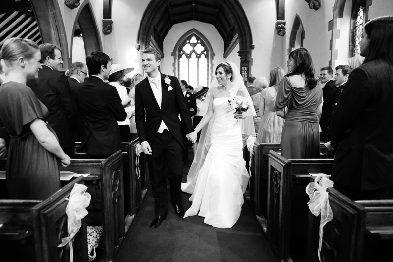 the bride and groom walking down the aisle, Toft Church, Knutsford wedding
