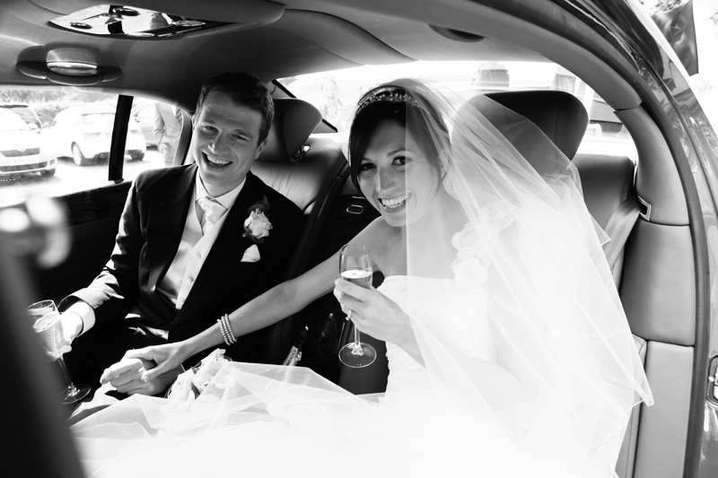 the bride and groom in car, Toft Church, Knutsford wedding