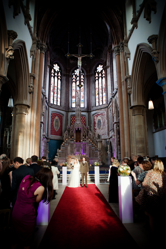 the bride and groom walking down the aisle, Gorton Monastery, Manchester wedding