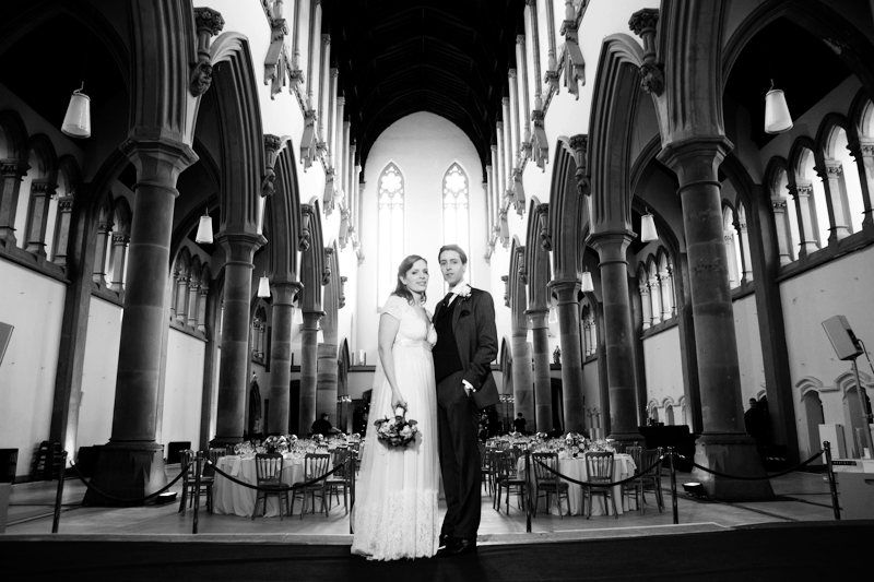 the bride and groom at their wedding reception in Gorton Monastery, Manchester